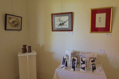 A quiet corner: sculptural work by Chris Johnston, with Richard Sullivan's art books and hanging works by (L-R) Maritsa Gronda & Gerard Menzel