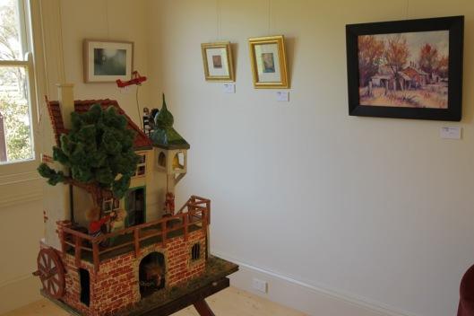 Marcus Goddefroy's puppet house, with works by (L-R) Sarah Koschak, Mary Caspar & Karen Pierce